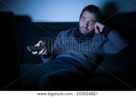 Bored Man Watching Television At Night