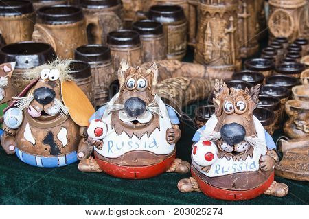 beautiful animal figurines made of clay, on the market. The Inscription Russia