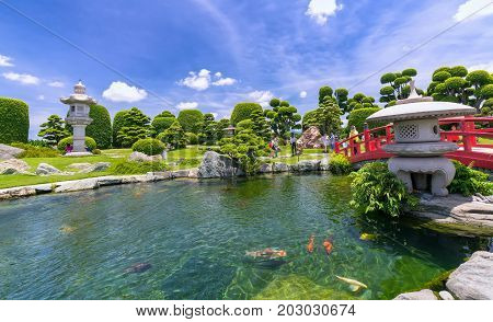 Ho Chi Minh City, Vietnam - September 3rd, 2017: Tourists visit garden bonsai in eco tourism with cypress, pine, stone and trees blend as beautiful paintings outskirts in Ho Chi Minh City, Vietnam