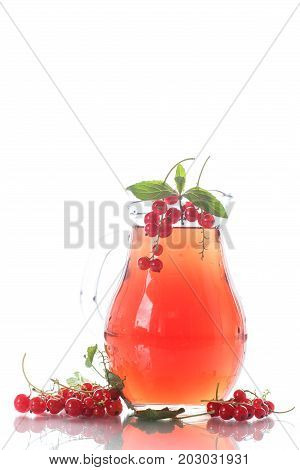 Fresh compote of ripe red currant in a glass decanter