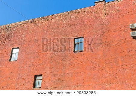 The wall of the house of red brick, firewall, Saint Petersburg, Russia.