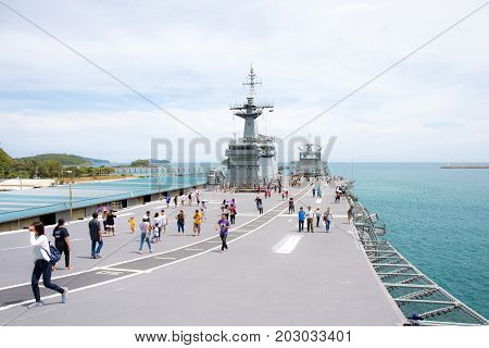 Rayong, Thailand, 13 August 2017: People or traveler visit the battle ship name Chakri Naruebet or Chakrinaruebet at the Royal Thai Navy of Rayong, Thailand.