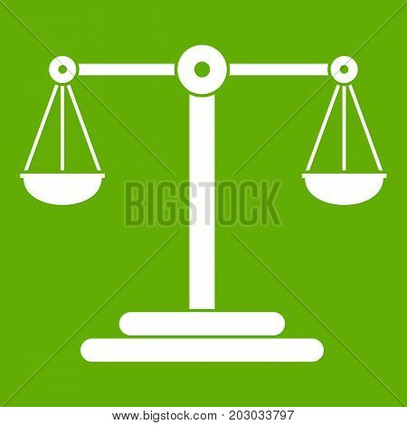 Scales balance icon white isolated on green background. Vector illustration