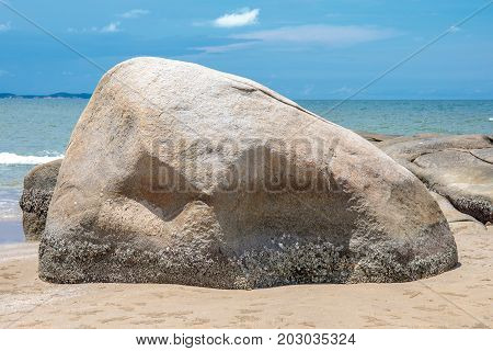 Big rock or stone on the sand sea beach.