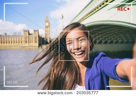 Selfie portrait travel woman recording video vlog on mobile phone. Camera screen of Asian tourist girl on London Europe vacation vlogging talking on live stream. UK european tourism destination