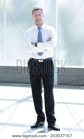 Full length portrait of confident mature businessman in formals