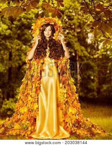 Autumn Woman Fashion Model in Fall Forest Girl in Autumnal Yellow Leaves Art Dress