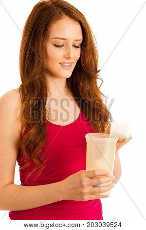 Attractive Beautiful Sporty Woman Prepare Protein Shake In A Shaker