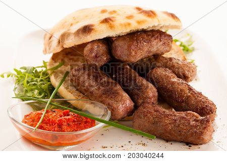 photo of Cevapi cevapcici traditional Balkan food - delicius minced meat