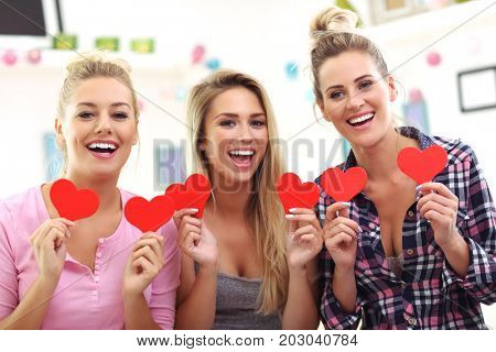 Three beautiful young women chilling at home