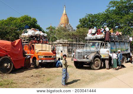 BAGAN MYANMAR - 19 JANUARY 2011: Pilgrims are going to ruins of ancient temples in Bagan Myanmar
