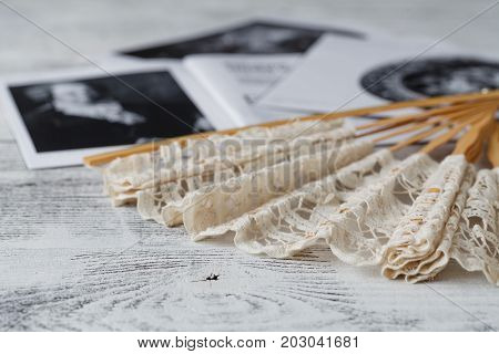 Theatrical Accessories. Fan On White Background And And Invitation