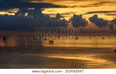 Landscape of Hut on the sea during sunrise.