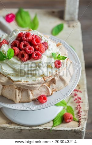 Homemade And Rustic Pavlova Dessert Made Of Mascarpone And Berries