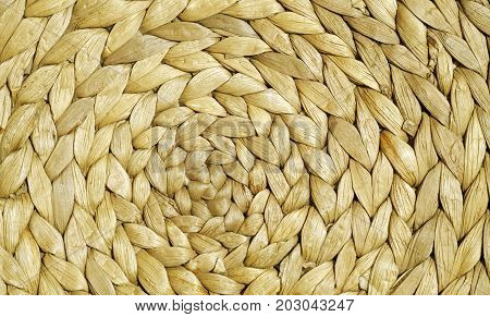 Yellow Color Straw Mat Surface With Round Pattern.
