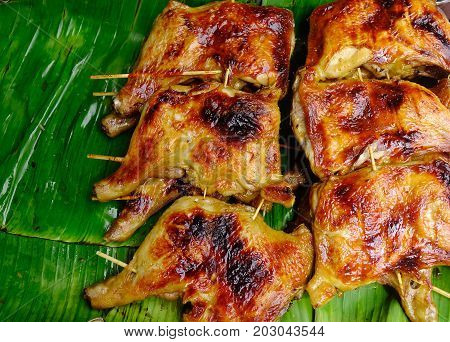 Grilled Chicken On Banana Leaves At Rural Market