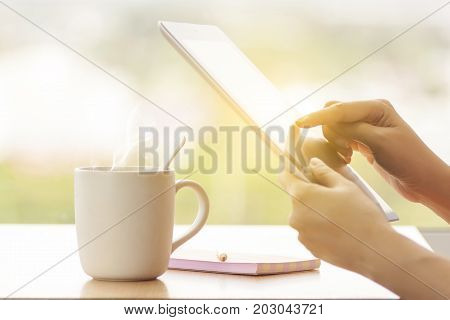 close up hands multitasking woman using tablet laptop and cellphone connecting wifi anonymous face