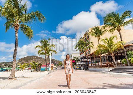 St Maarten Woman tourist walking in shopping streets of Philipsburg, St Maarten, popular port of call for cruise ship travel destination. Caribbean tropical getaway.