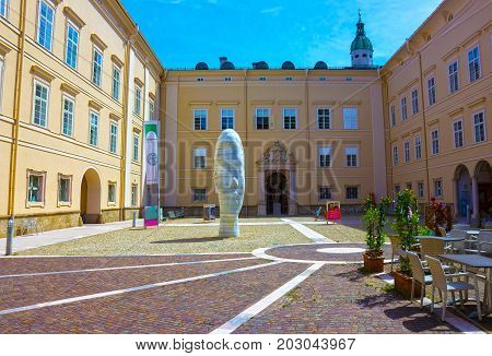 Salzburg, Austria - May 01, 2017: The old part of the city of Salzburg, a sculpture of the head at Salzburg, Austria on May 01, 2017