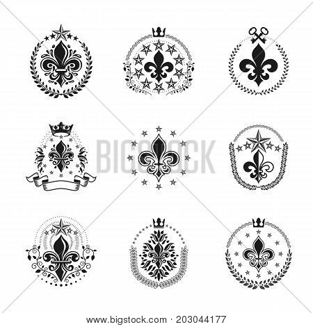 Lily Flowers Royal symbols emblems set. Heraldic Coat of Arms decorative logotypes isolated vector illustrations collection.