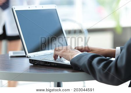 Picture of hands of business man  working on laptop.