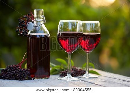 Glasses Of Elderberry Wine And Elderberries