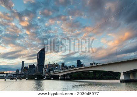 Brisbane, Australia - July 9, 2017: Captain Cook Bridge over the Brisbane River, with the skyline in the background. Captain Cook Bridge opened in 1972.
