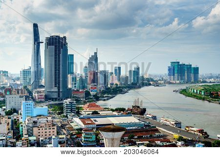 HO CHI MINH, VIETNAM - AUG 02, 2017: Aerial view of Ho Chi Minh city, Vietnam. Beauty skyscrapers along river light smooth down urban development in Ho Chi Minh City, Vietnam.