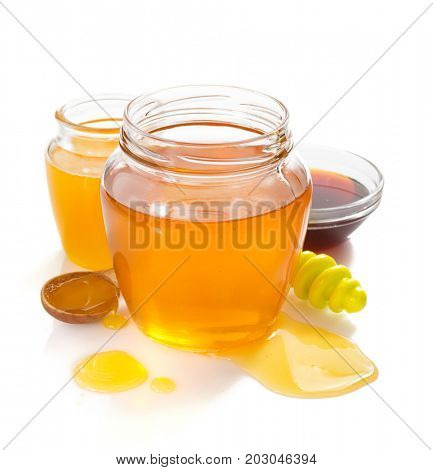 variety of honey in jar isolated on white background