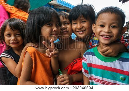 SIHANOUKVILLE CAMBODIA - 7/20/2015: A group of children play in the streets of their fishing village.