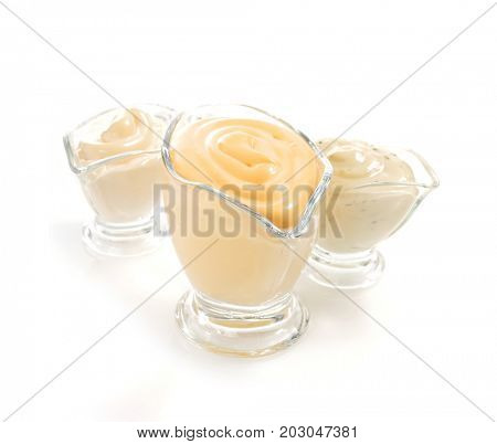 mayonnaise sauce in gravy boat isolated on white background