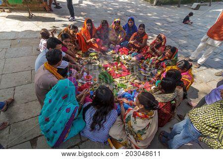 KATHMANDU NEPAL - 9/26/2015: Hindu women in traditional sari sit in a circle at Durbar Square in Kathmandu Nepal.