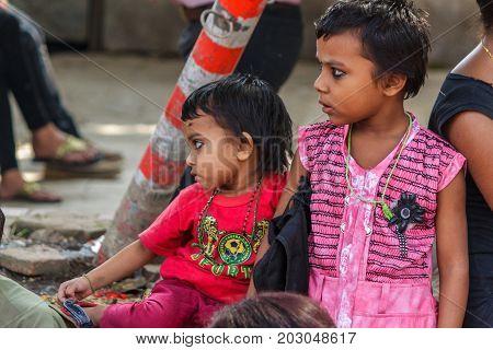 KATHMANDU NEPAL - 9/26/2015: Hindu children at Durbar Square during the Indra Jatra festival in Kathmandu Nepal