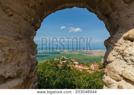 view of the Alazani Dalyna from the fortress. Old city wall from stones with towers round a city Sighnaghi. Kakheti. Georgia. It is City of Love in Georgia.
