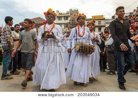 KATHMANDU NEPAL - 9/26/2015: Musical performers walk through the crowd during the Indra Jatra festival at Durbar Square in Kathmandu Nepal.