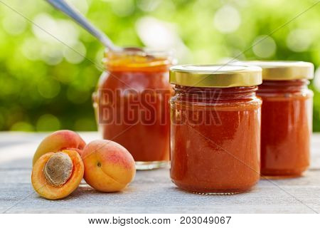 Apricot Jam In Glass Jars With Fresh Fruit