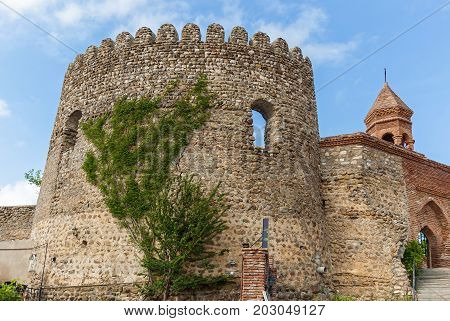 Old city wall from stones with towers round a city Sighnaghi. Kakheti. Georgia. It is City of Love in Georgia.
