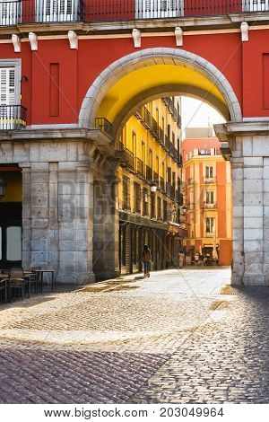 One of the 9 arched gates in Plaza Mayor Madrid Spain.