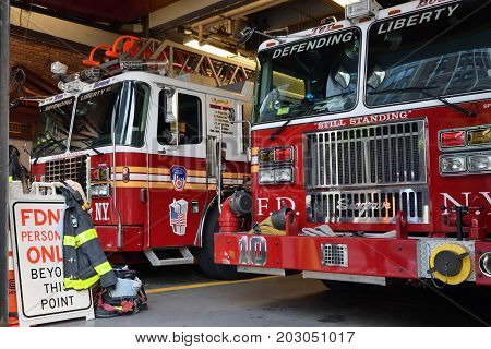NEW YORK CITY USA - AUG. 23 : FDNY fire truck parked in the fire station in Manhattan on August 23 2017 in New York City NY. Manhattan is the most densely populated borough of New York City.