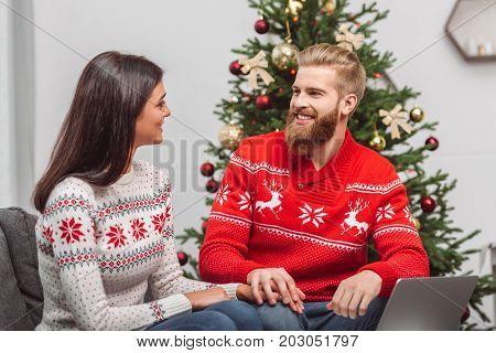 Couple Using Laptop At Christmastime