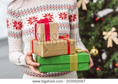 Girl Holding Christmas Presents
