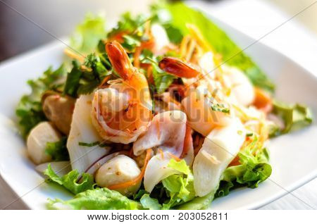 Seafood Salad, Mixed seafood, onion, carrot and cilantro in a spicy lime sauce