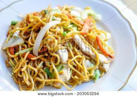 Lo Mein Noodle, Stir-fried Lo Mein noodles, carrot, onion, napa, and celery with brown sauce