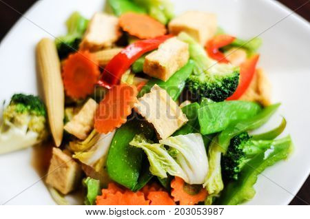 Stir-Fried Mixed Vegetables, Stir-fried broccoli, baby corn, carrots, peapods, napa and bell pepper in a soy sauce