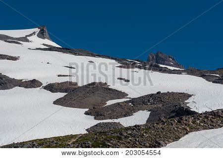 Mountaineers Cross Snow Field On Mount Rainier