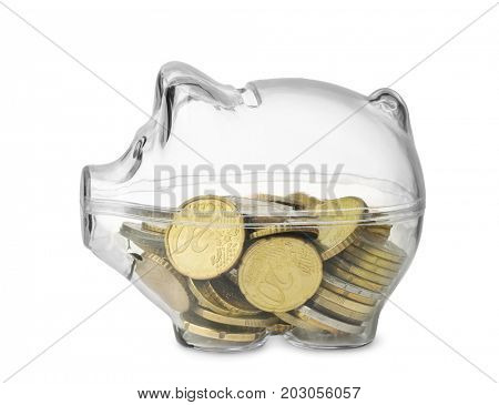Side view of transparent piggy bank with euro coins isolated on white