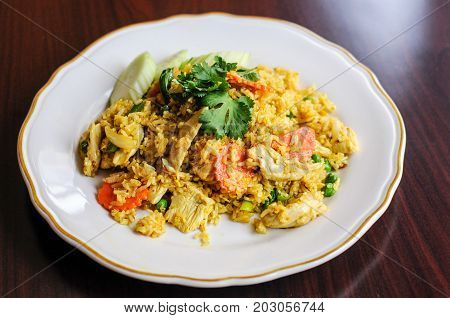 Curry Fried Rice, Stir-fried with egg, onions, green peas, carrots and seasoned with curry powder