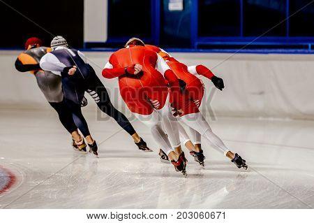 group speed skaters men warm-up in speed skating