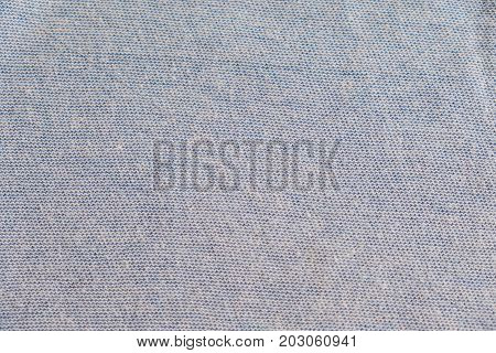 Grey heather texture. Grey fabric texture. Background with delicate striped pattern. Real heather grey knitted fabric made of synthetic fibres textured background.