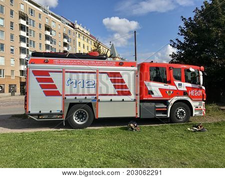 HELSINKI - SEPTEMBER 6, 2017: A fire engine parked on the side of the road in Helsinki, Finland.